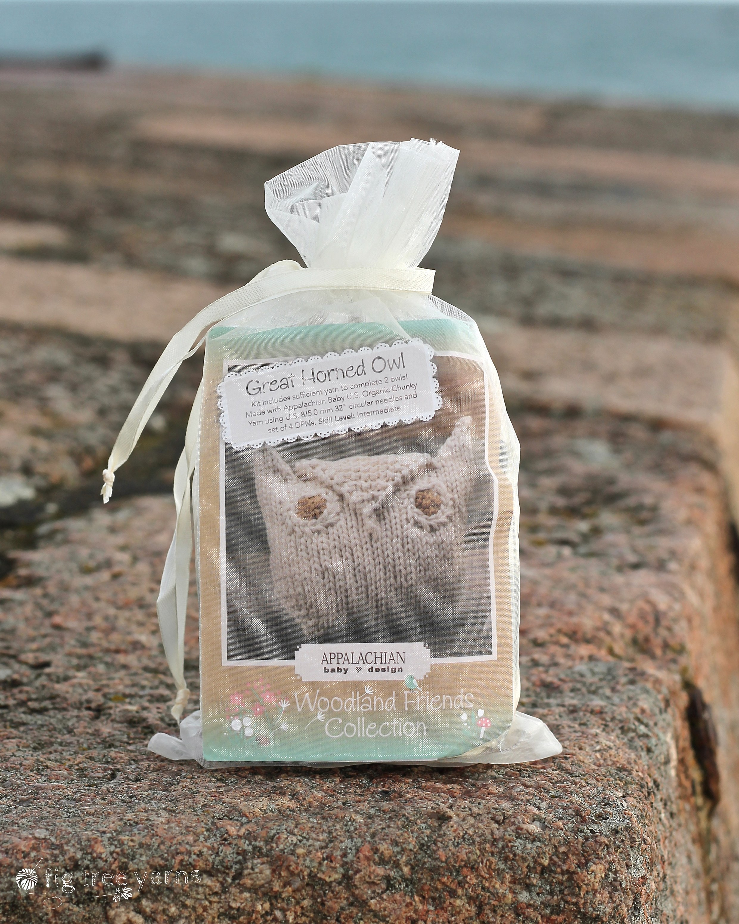 Appalachian Baby great horned owl toy kit on beach wall by Fig Tree Yarns