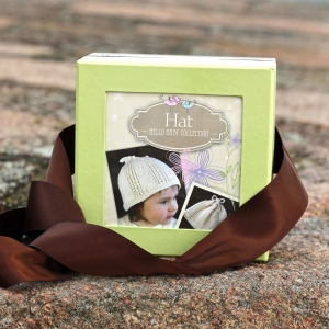Appalachian Baby hello baby hat kit on beach wall by Fig Tree Yarns
