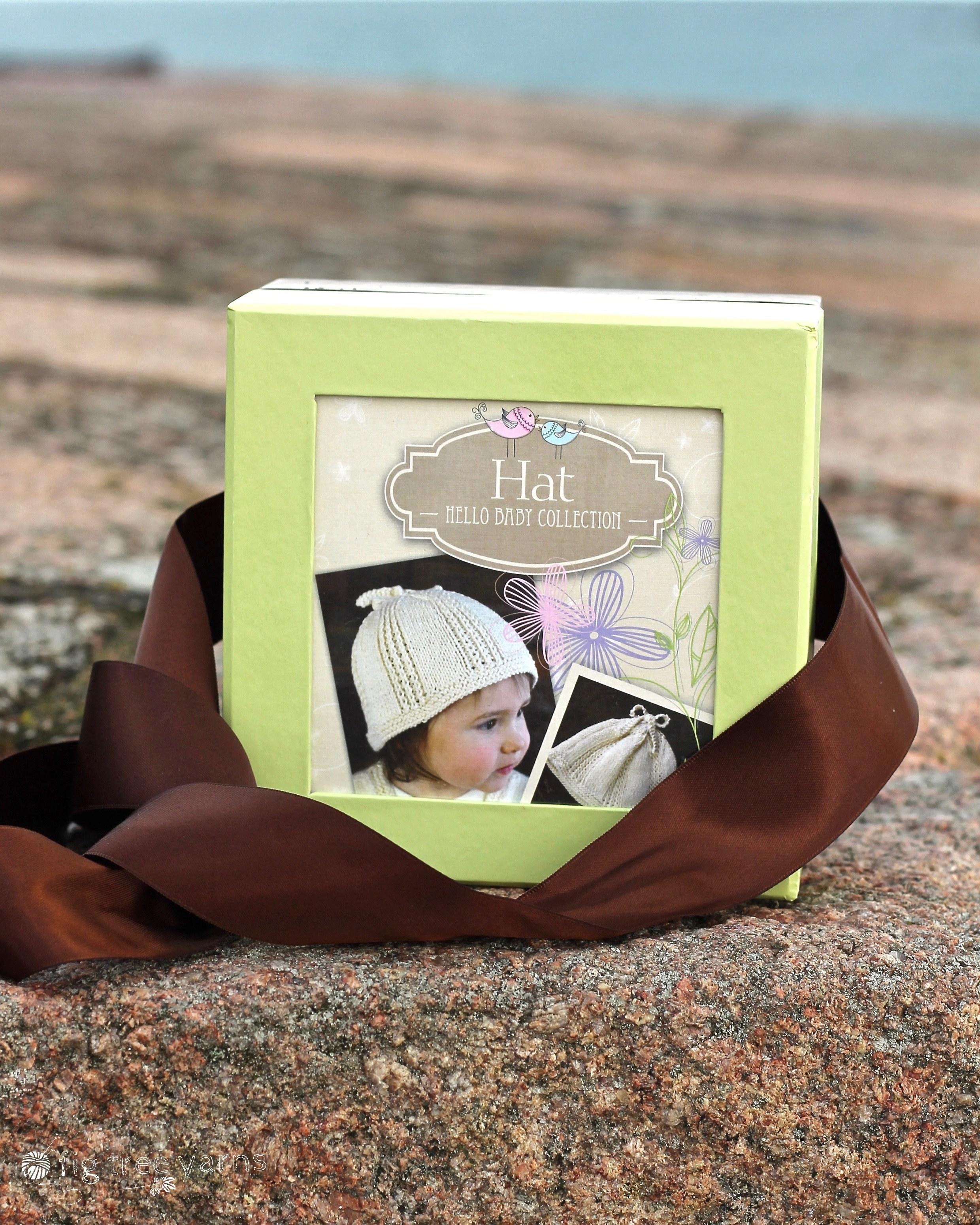 Appalachian Baby hello baby hat kit on beach wall by Fig Tree Yarns
