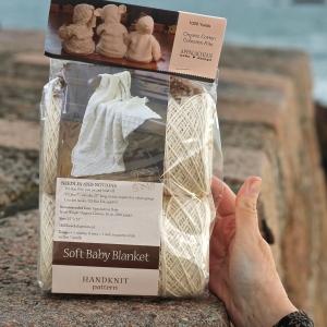 Appalachian Baby soft baby blanket kit on beach wall by Fig Tree Yarns