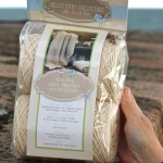 Appalachian Baby stair step blanket on beach wall packet by Fig Tree Yarns