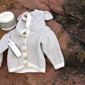 Appalachian Baby baby bear cardigan on beach steps by Fig Tree Yarns