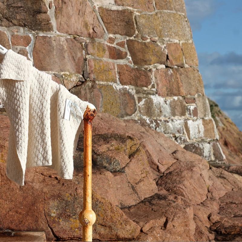 Appalachian Baby stair step blanket on beach rail by Fig Tree Yarns